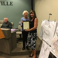 Sue Coyle, CEO Chartiers Center, accepts proclamation for 50 years of service from Mayor Betty Copeland.