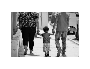 family holding hands in blk white photo OP Services