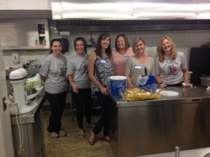 Volunteers from Victorian Finance in Bridgeville serve lunch at Chartiers' IDD Program in Dormont.