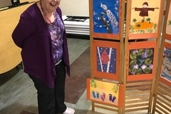"Cindy is standing next to her ""flip flops"" picture (bottom right)."